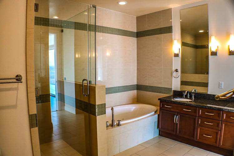 Bathroom with shower and tub at The Heights at Park Lane in Dallas, Texas
