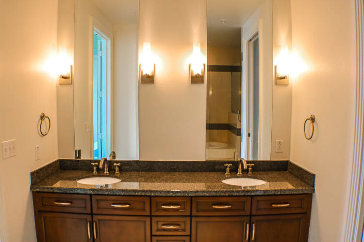 Bathroom with double sinks at The Heights at Park Lane in Dallas, Texas