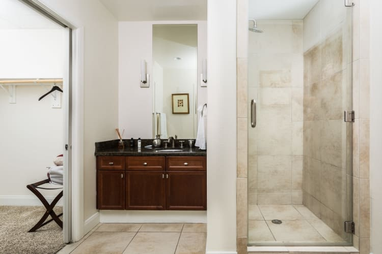 Bathrooms with white accents at The Heights at Park Lane in Dallas, Texas