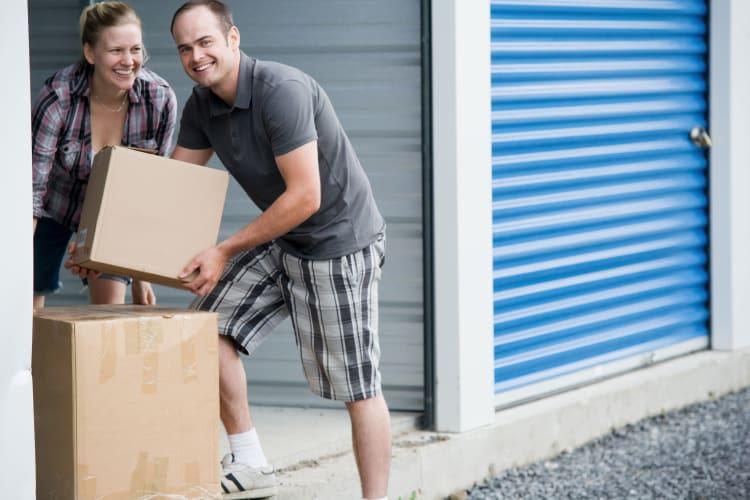 Man holding a box at Storage Star Mopac in Austin, Texas