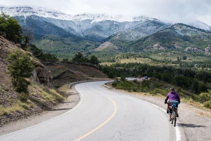 Biking down a road
