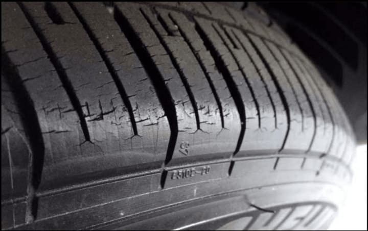 a tire with visible cracks from dry rotting