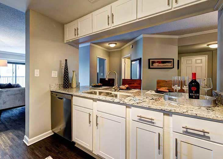 The kitchens at The Eva are nicely designed with simple but classy white cabinetry.