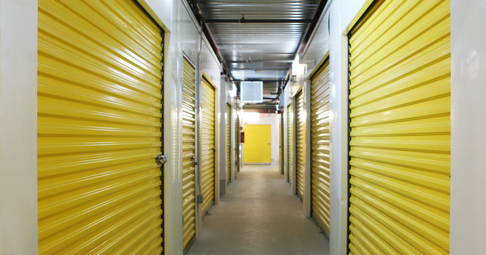 Storage units with yellow doors at Midgard Self Storage in Roswell, Georgia