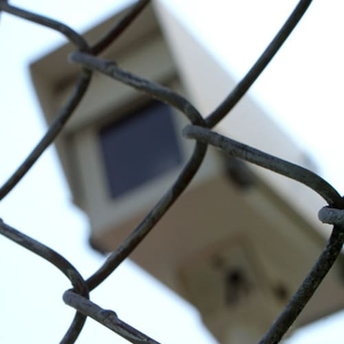 Security camera behind a fence at Red Dot Storage in St. Joseph, Missouri