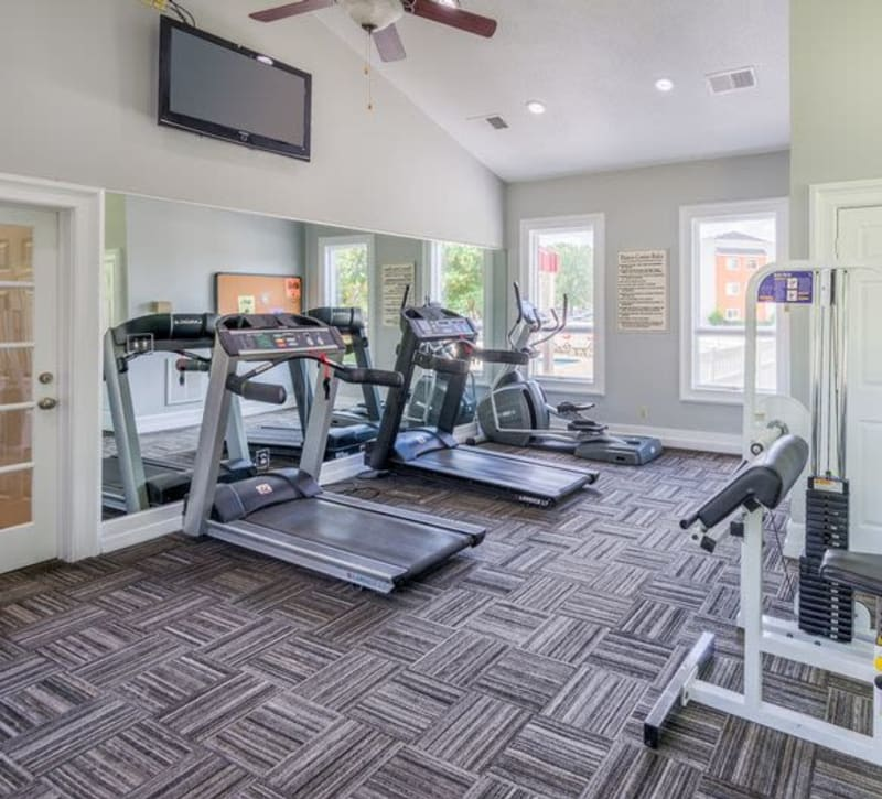 A fitness center with individual workout stations at The Samuel in Hampton, Virginia