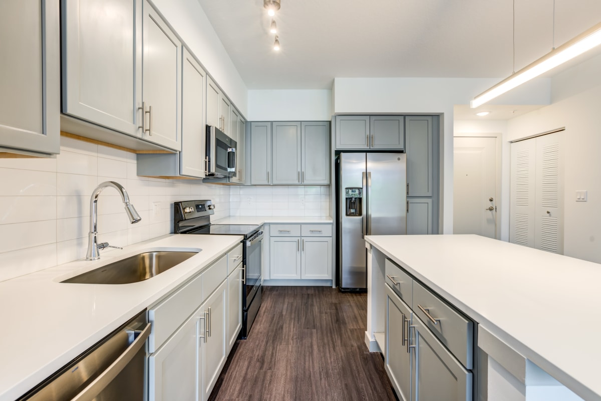Kitchen with stainless steel countertops at Solera at City Centre in Palm Beach Gardens, Florida