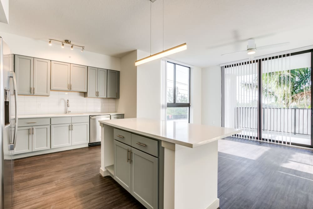 Kitchen and living room views of a vacant apartment home at Solera at City Centre in Palm Beach Gardens, Florida