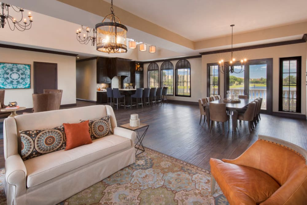 Resident clubhouse interior with lounge seating at Town Fontainebleau Lakes Apartment Residences in Miami, Florida