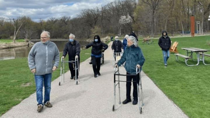 Highline Place Memory Care Littleton, Colorado residents walking