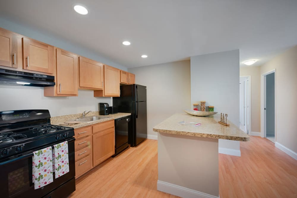 A large kitchen with an island at The Landings I & II Apartments in Alexandria, Virginia