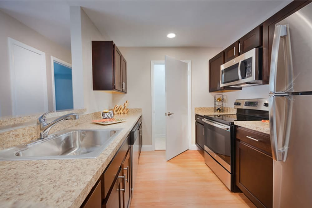 A kitchen with plenty of cabinetry at The Landings I & II Apartments in Alexandria, Virginia