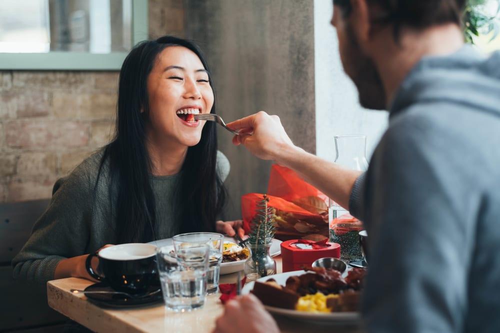 Couple having dinner near Suburban Terrace in Hackensack, New Jersey