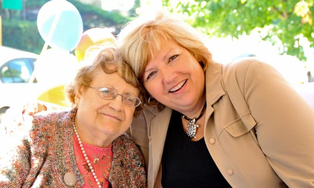Resident and caregiver at a Maplewood Senior Living community