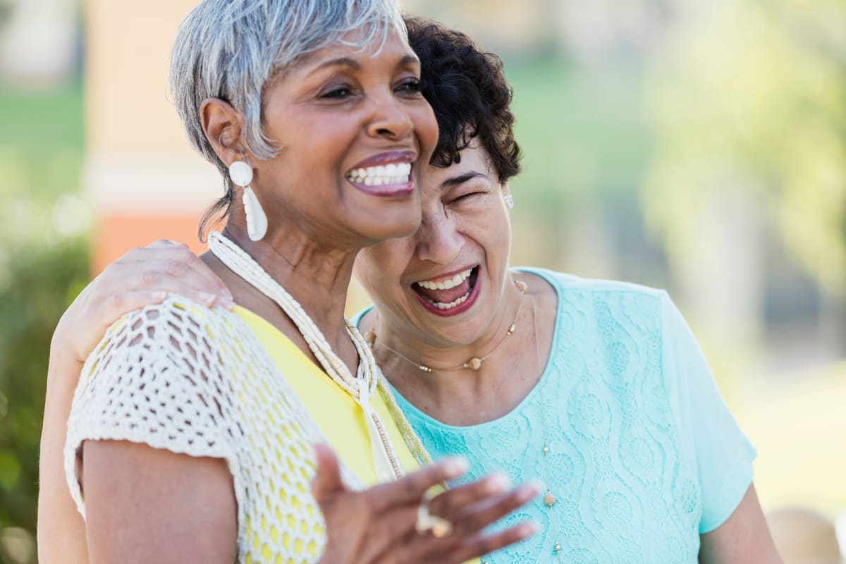 Two residents laughing and having a good time at Lake Morton Plaza in Lakeland, Florida
