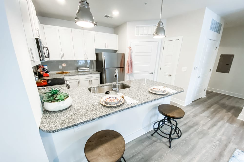 Model kitchen with breakfast bar at South City Apartments in Summerville, South Carolina