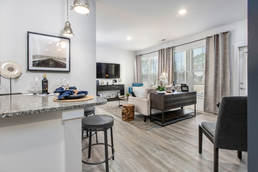 Model living room and breakfast bar at South City Apartments in Summerville, South Carolina