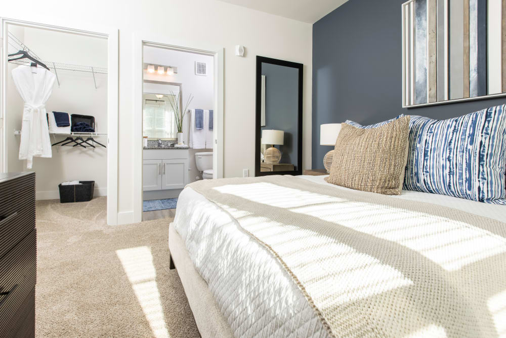 Brightly lit bedroom suite at South City Apartments in Summerville, South Carolina