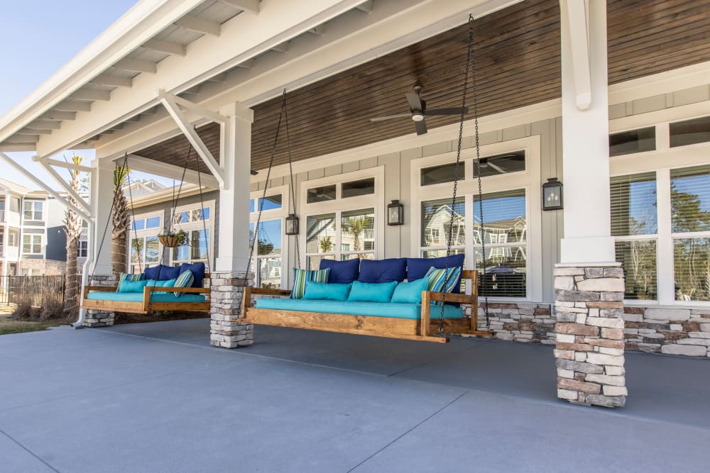 Outdoor bench swings at South City Apartments in Summerville, South Carolina