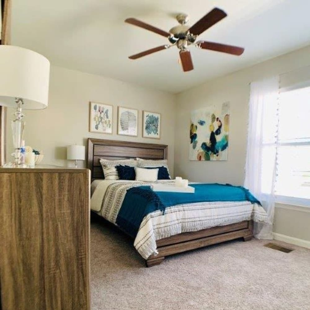 Modern bedroom with ceiling fan at Villas at Greenview West in Great Mills, Maryland