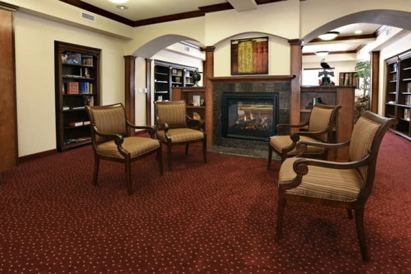 Cozy seating in the library at Magnolia Heights Gracious Retirement Living in Franklin, Massachusetts