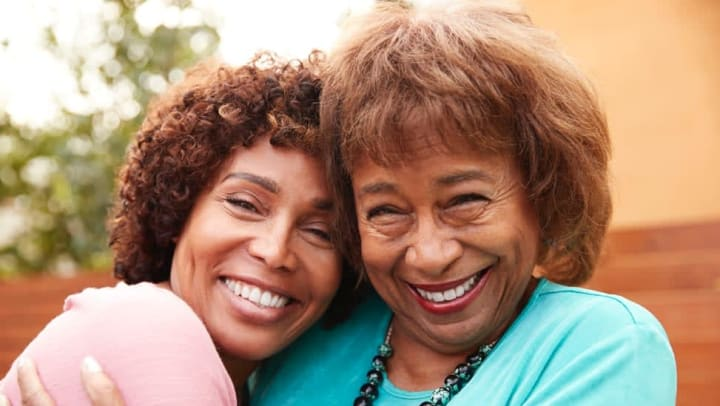Two women smiling together