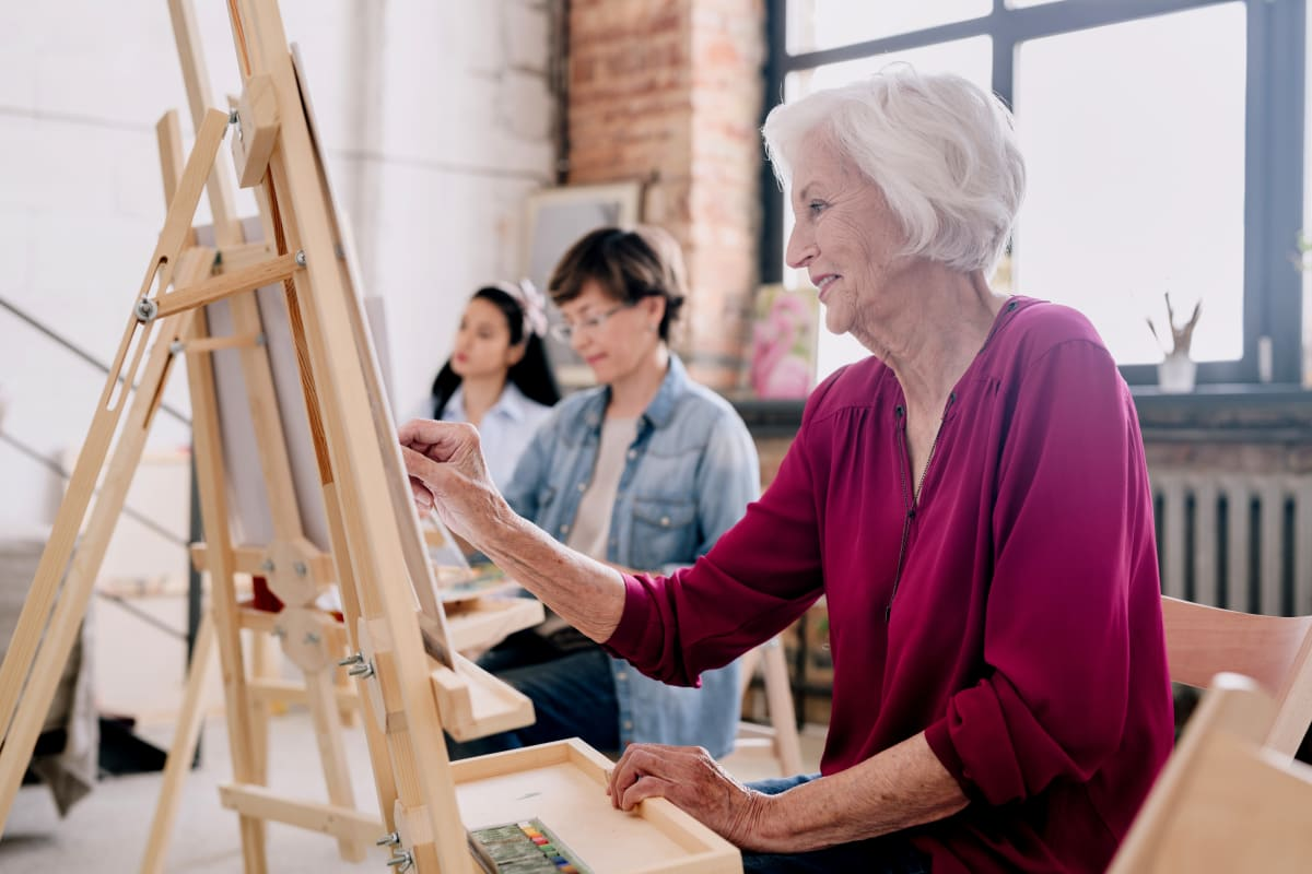 Residents painting in an artist studio at The Meridian at Brandon in Tampa, Florida