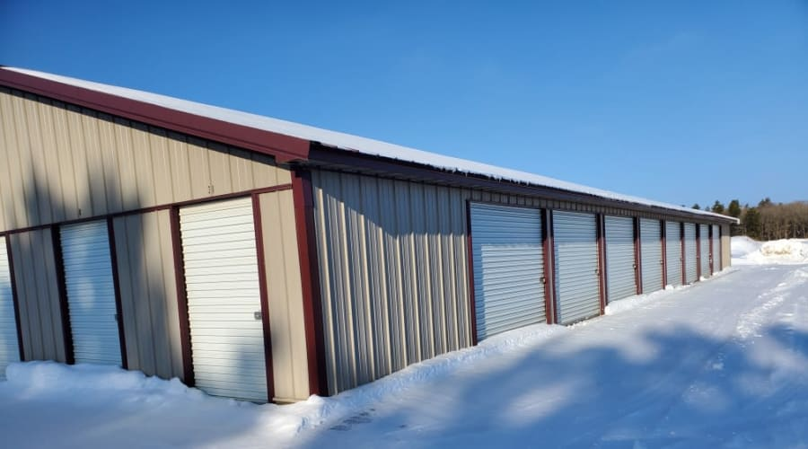 Storage units with white doors and locks at KO Storage of Cass County in Pillager, Minnesota