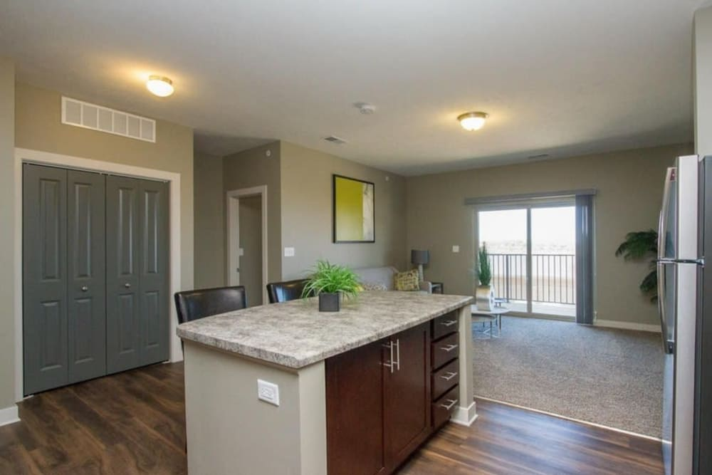Kitchen with an island at The Summit at Sunnybrook Village in Sioux City, Iowa