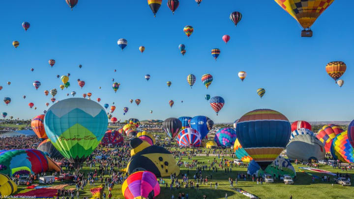 Dozens of hot air balloons launching in a blog article on our website at Olympus Solaire in Albuquerque, New Mexico