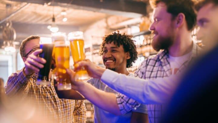 Friends raising a toast at their favorite pub near The Slate in Savannah, Georgia