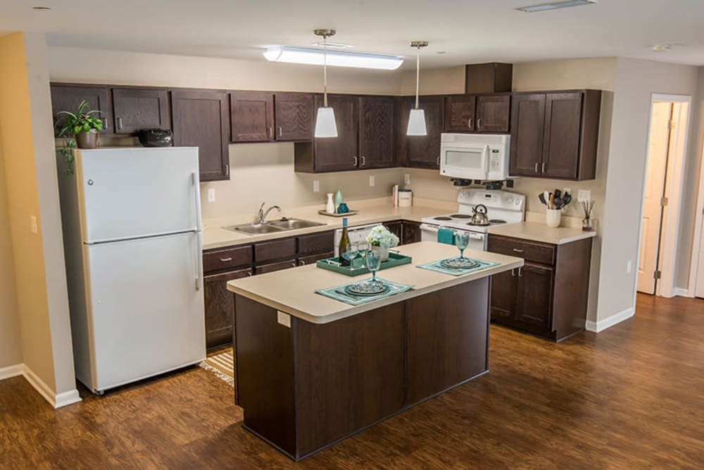 A spacious kitchen with beautiful wood-style cabinets at Silver Lake Hills in Fenton, Michigan