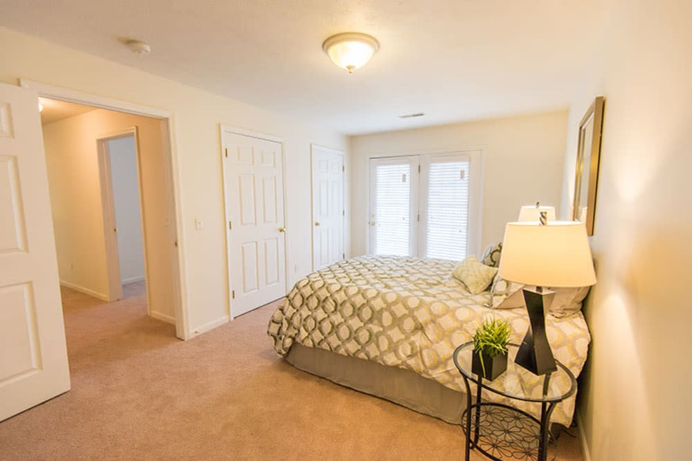 Spacious main bedroom with a large window for natural lighting at Silver Lake Hills in Fenton, Michigan