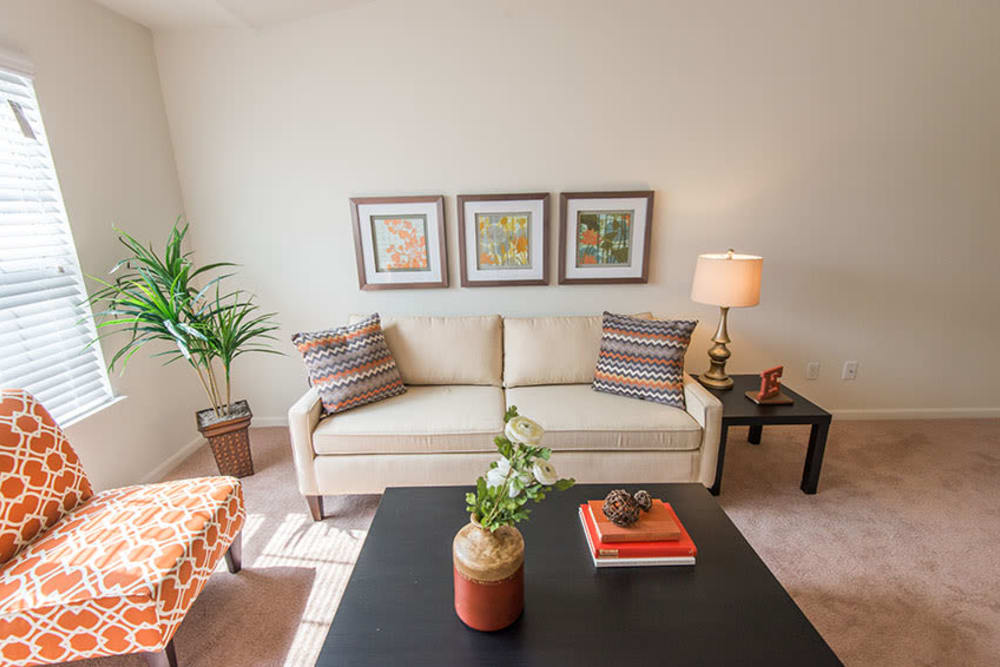 A beautifully decorated living room in the model home at Silver Lake Hills in Fenton, Michigan