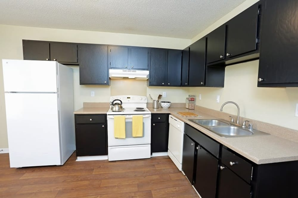 Kitchen with black appliances at Madison Pines in Madison, Alabama