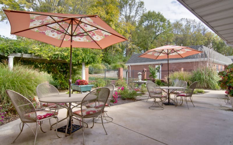 Outdoor patio with chairs at South Pointe Senior Living in Washington, Missouri