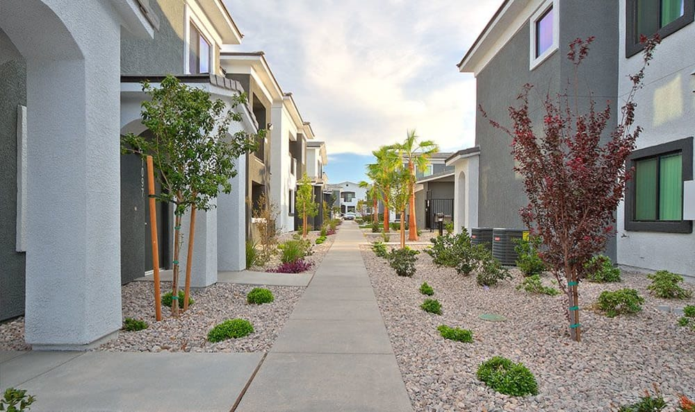 Well-manicured landscaping and resident buildings at SW Apartments in Las Vegas