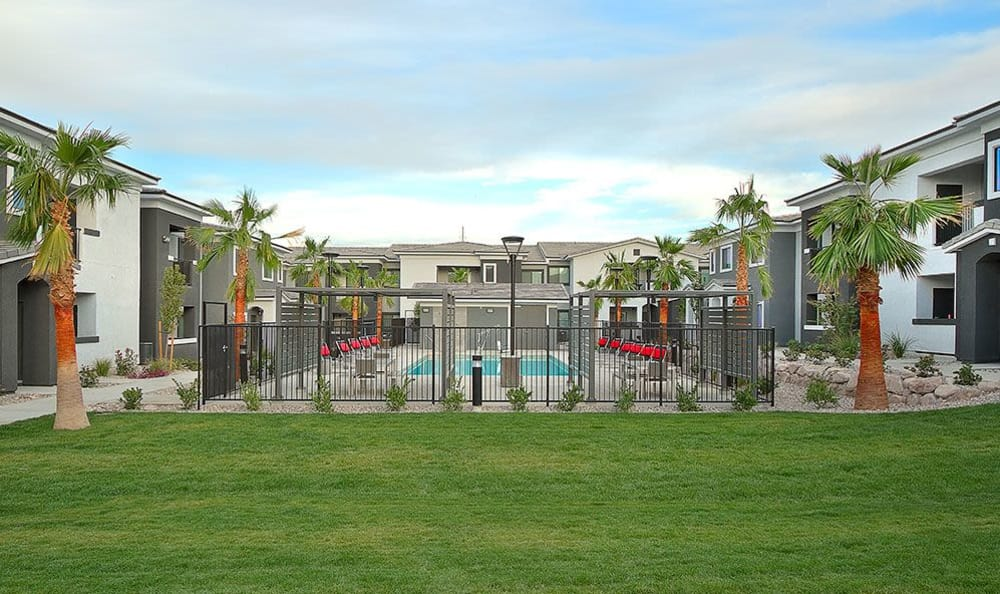 Plenty of green grass and well-kept outdoor common areas at SW Apartments in Las Vegas
