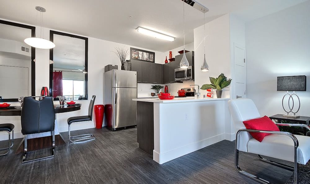 Model home at SW Apartments in Las Vegas showcasing modern a kitchen and hardwood floors