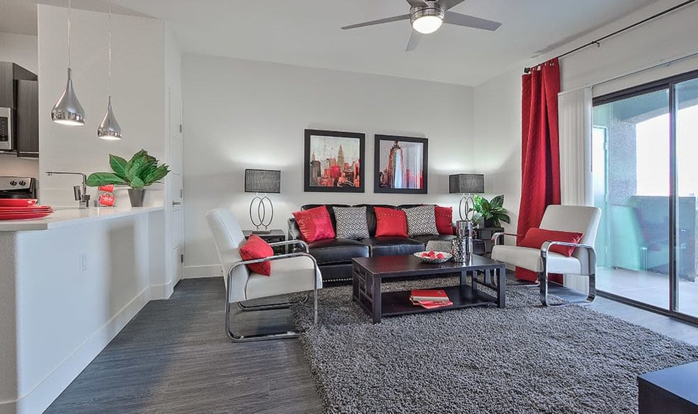 Open living room with contemporary furnishings in model home at SW Apartments in Las Vegas