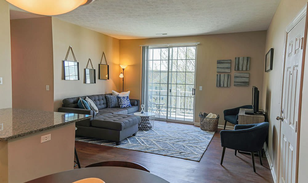 Well-lit living room at The Preserve at Beckett Ridge, in West Chester, Ohio
