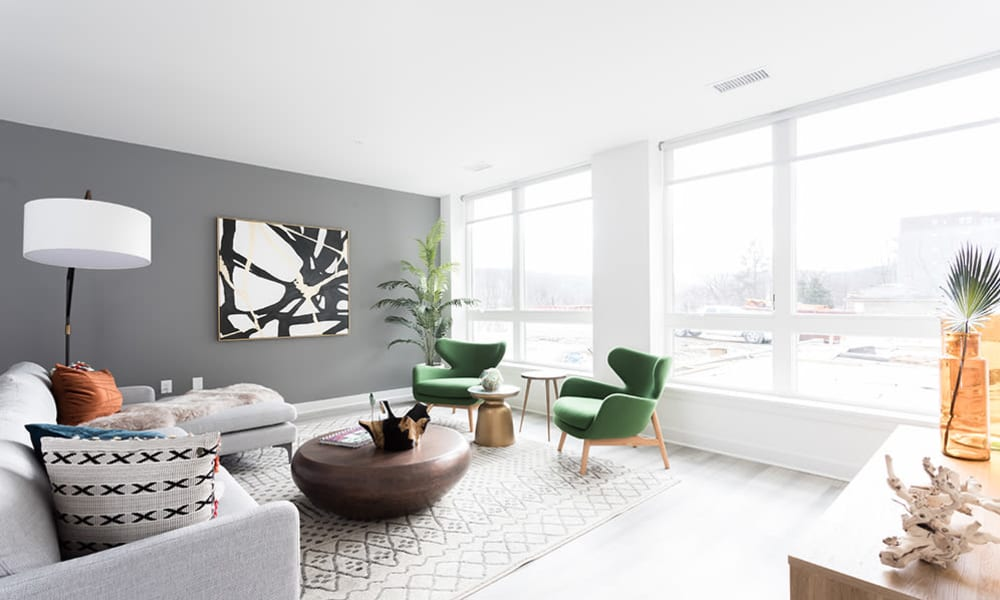 Naturally well-lit living room in a model home at 50 Front Luxury Apartments in Binghamton, New York