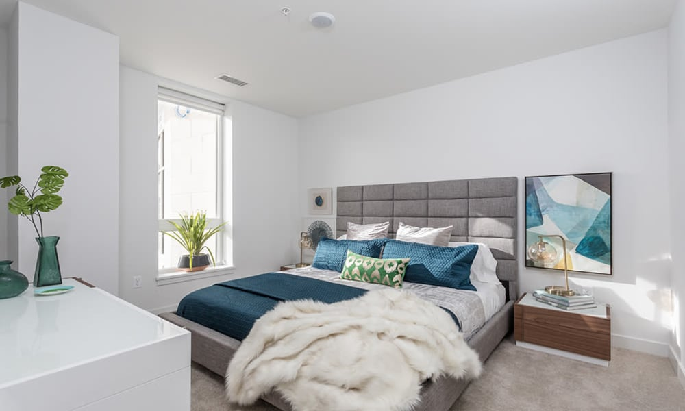 Cozy bedroom in a model home at 50 Front Luxury Apartments in Binghamton, New York