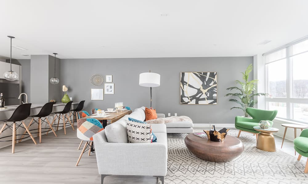 Spacious open-concept layout in a model home's living area at 50 Front Luxury Apartments in Binghamton, New York