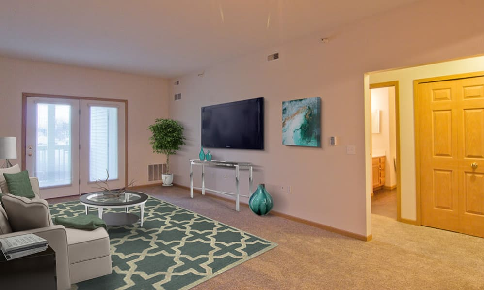 Spacious and modern living room at Steeplechase Apartments & Townhomes in Toledo, Ohio