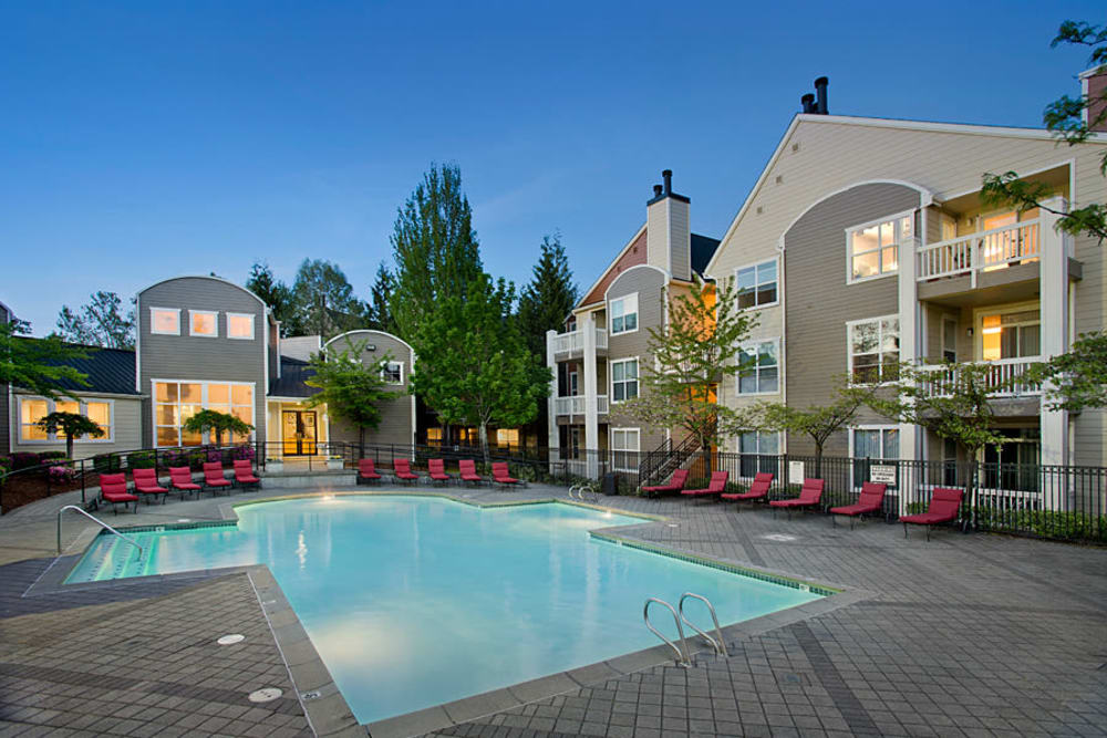 Swimming pool with plenty of lounge chairs at Center Pointe Apartment Homes in Beaverton, Oregon