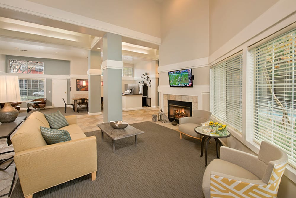 A clubhouse with plenty of seating for entertaining guests at Mill Springs Park Apartment Homes in Livermore, California