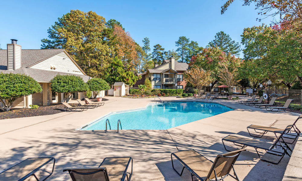 Poolside seating at Beech Lake Apartments in Durham, NC