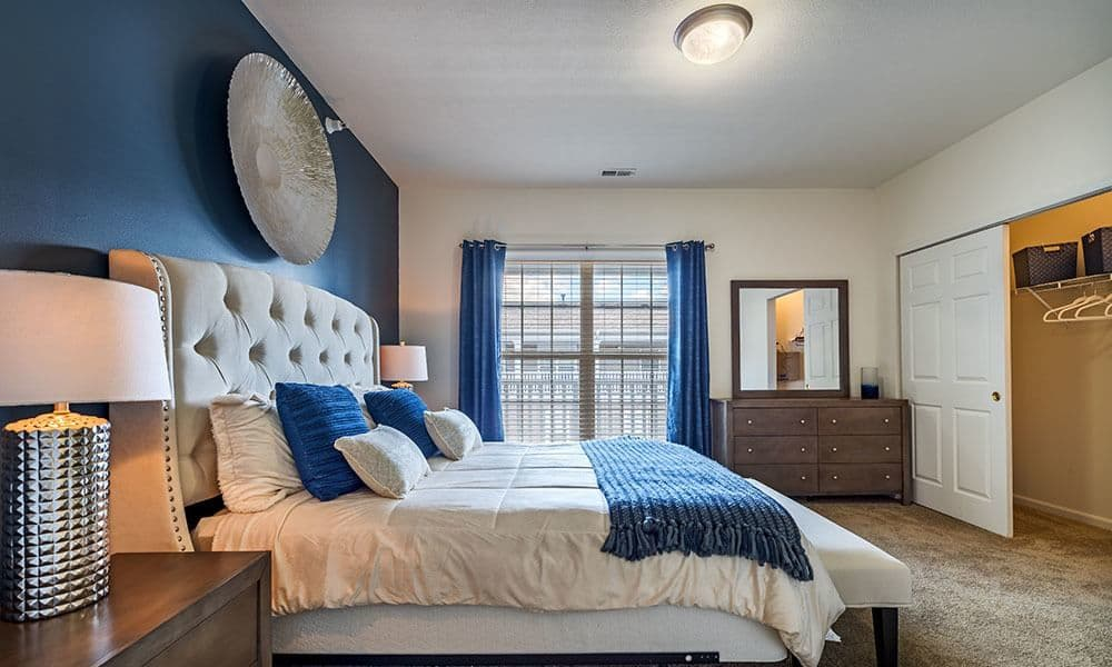 Bright inviting bedroom at The Docks in Pittsburgh, Pennsylvania