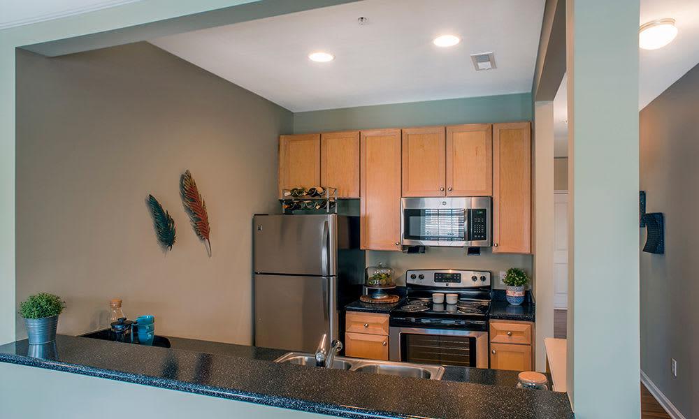 Kitchen with breakfast bar in Charlotte North Carolina at Worthington Luxury Apartments